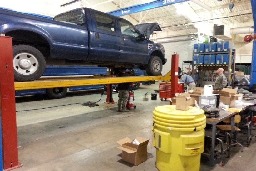 Blue truck on a lift.